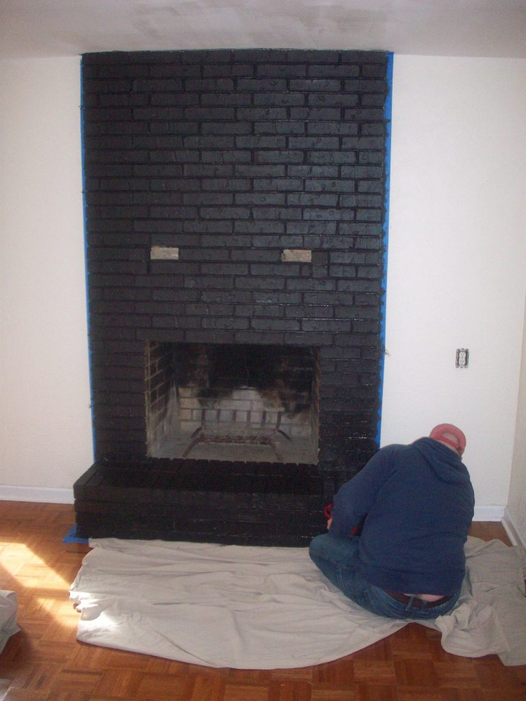 Jamie Priming the Fireplace Large Shot