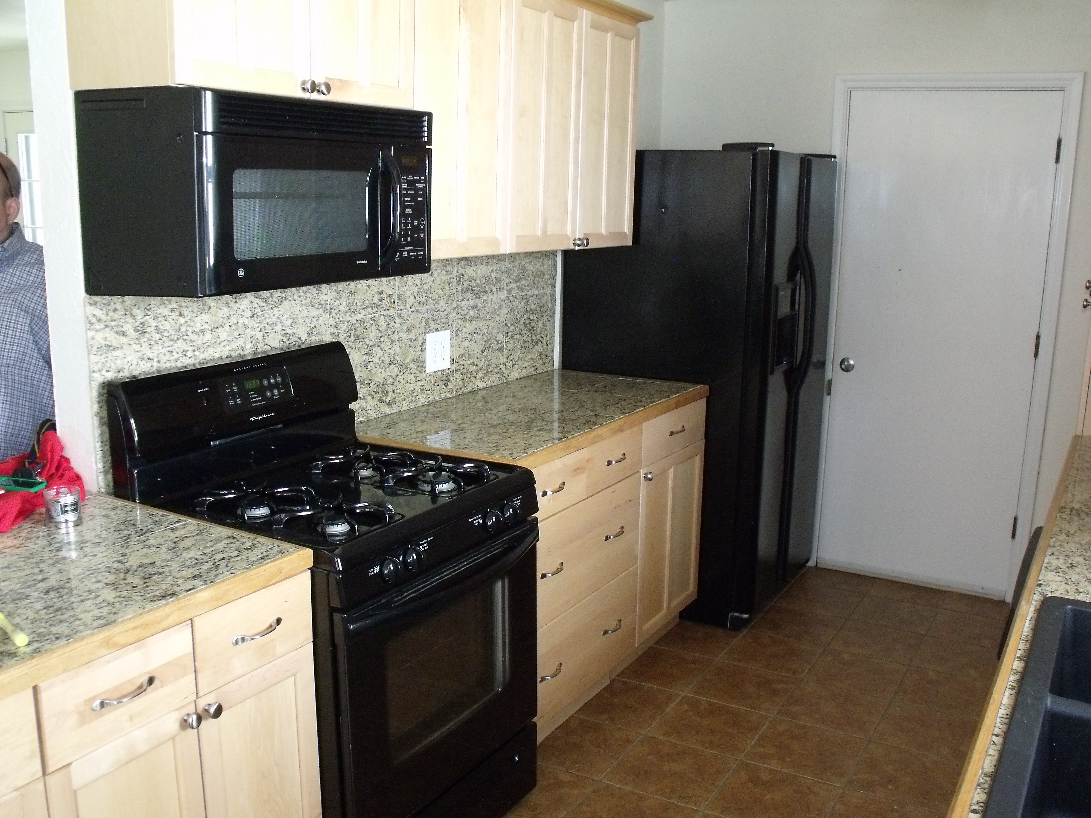Cream Kitchen Cabinets With Black Appliances  Quicuacom - Kitchen designs sa