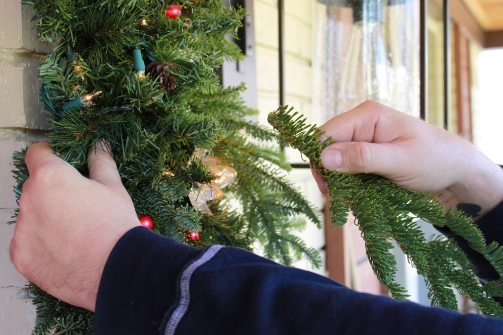 Inserting Fresh Pine over the Silk Garland