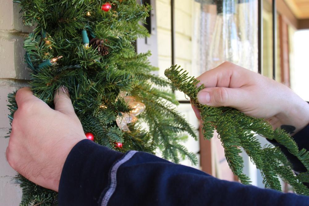 Inserting Fresh Pine over the Silk Garland