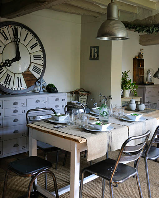 Huge Clock in Dining Room with pendant and metal chairs