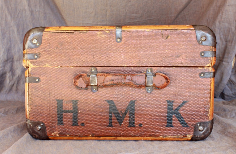 H. M. K. on side of Vintage Trunk
