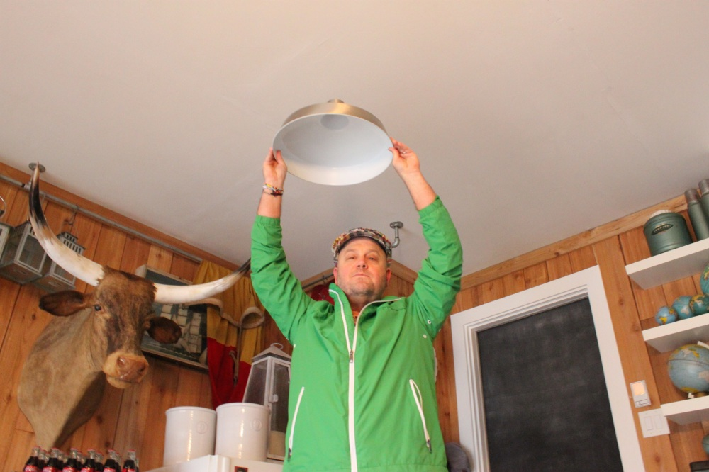 Jamie Holding Barn Pendant Light in Place