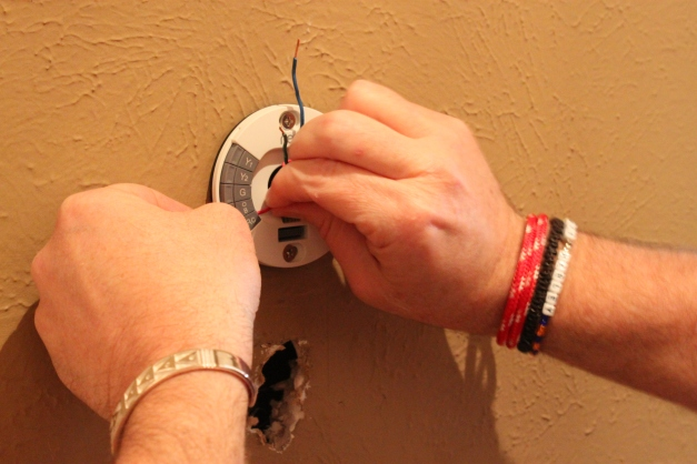Jamie Attaching the Nest thermostat