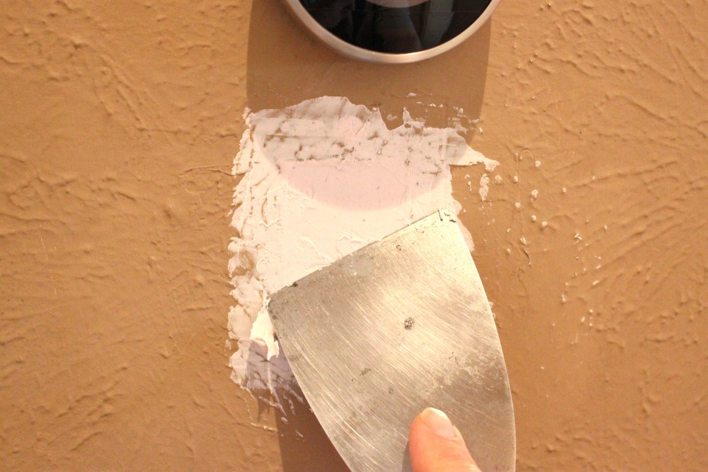 Spreading the Spackle with a Putty Knife