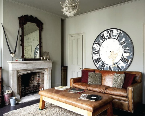 Big Clock over Leather Studded Sofa