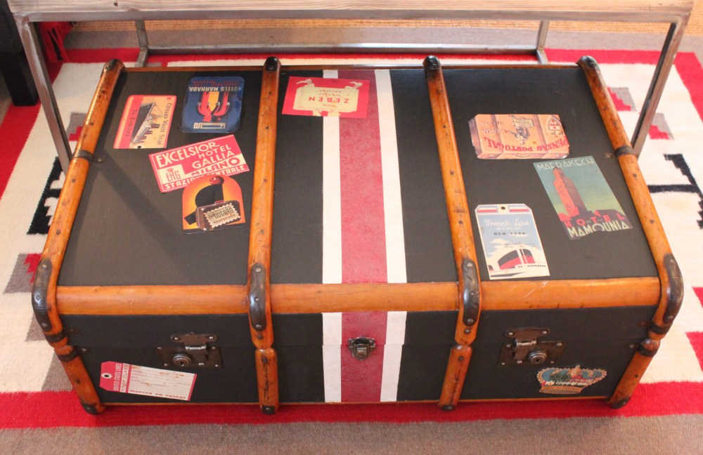Black Painted trunk with Plenty of Travel Stickers