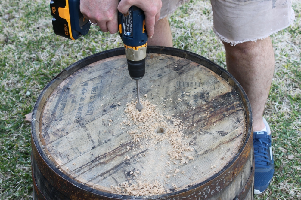Jamie Drilling Drainage Holes in the Bottom of a Whiskey Barrel