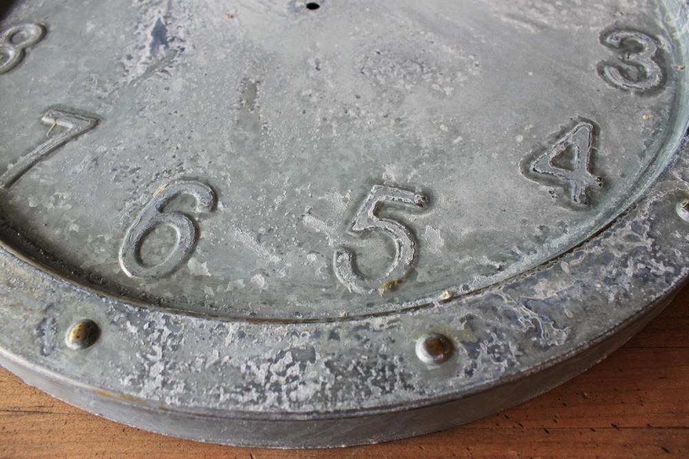 Close up of Weathered Galvanized Clock