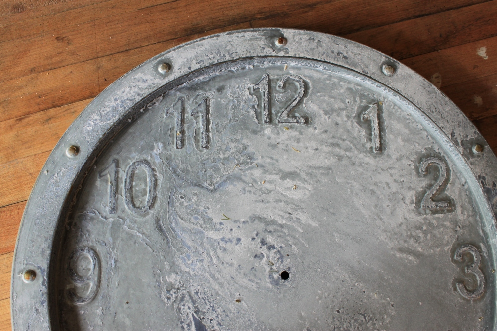 Close up of Weathered Galvanized Clock