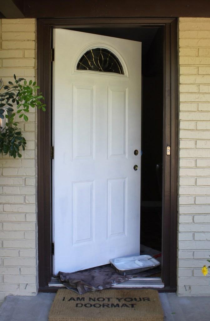 Primed Front Door Waiting to Be Painted Orange