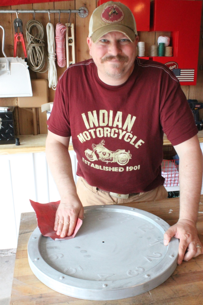 James Sanding the Coating off the Galvanized Clock