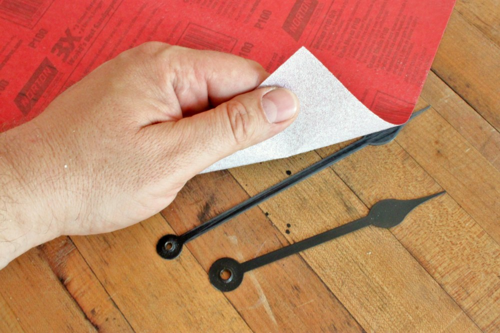 Sandpaper over the Hands to Age them Slightly