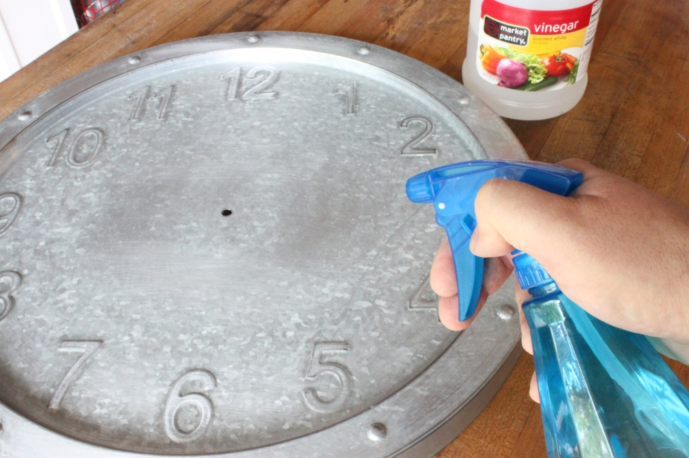 Spritzing the Clock with White Vinegar