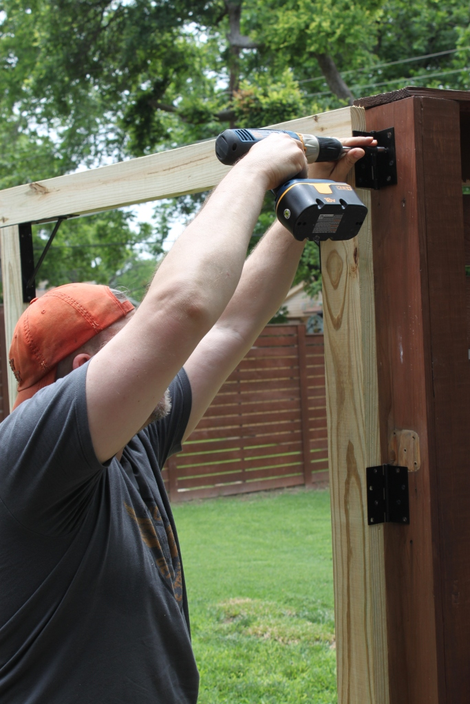 James Screwing on the Hinges for the New Gate
