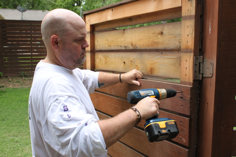 Jamie Removing the Old Slats from the Gate