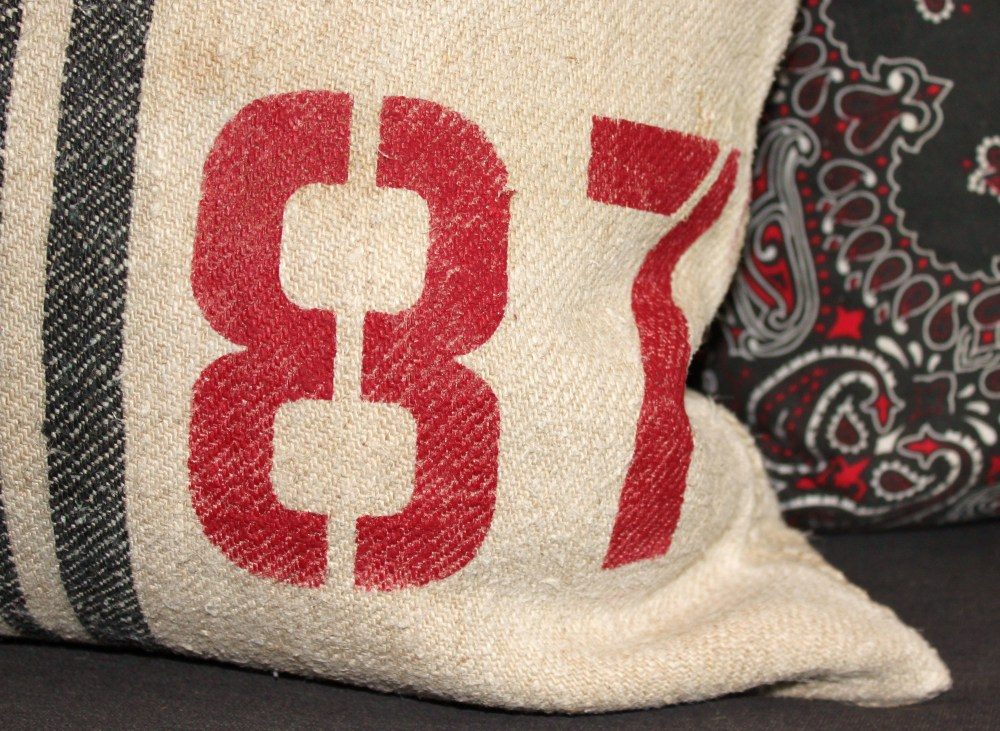 Close up Of 87 Painted on Grain Sack Pillow