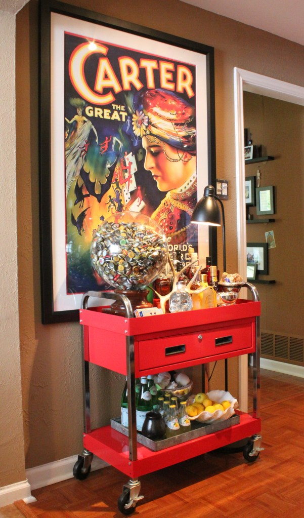 Large Poster of Carter Framed over the BAr Cart