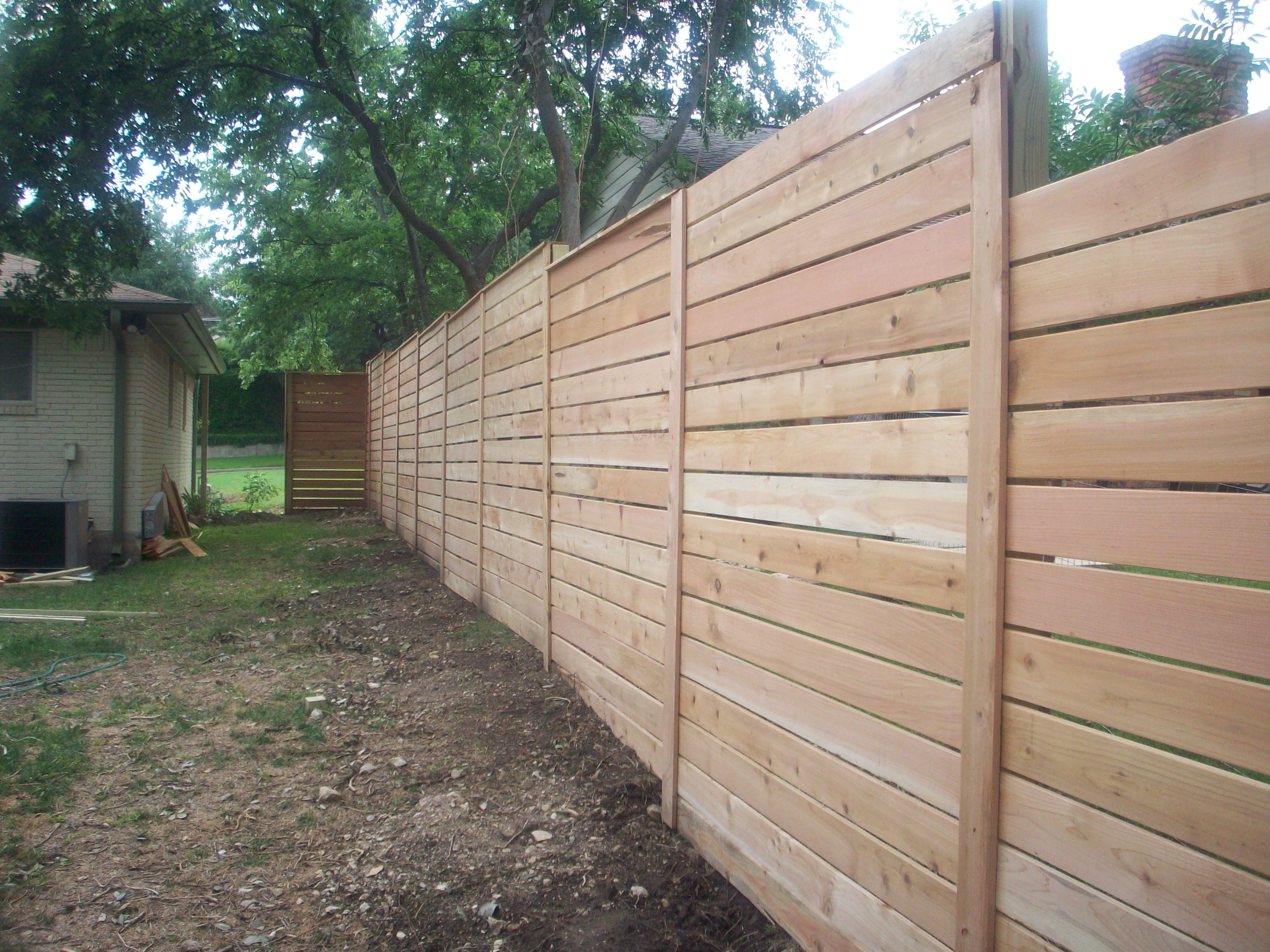 Contemporary Backyard Fences : The horizontal fence created that perfectly odd little ?prison yard
