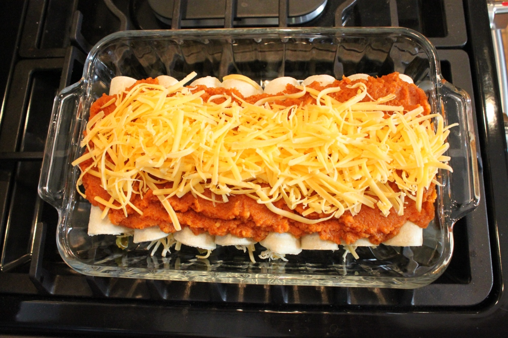 Pumpkin Enchiladas with Sauce and Cheese Ready For Baking