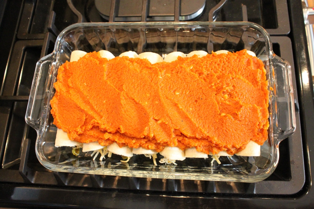 Pumpkin Enchiladas with Sauce Spread on Top