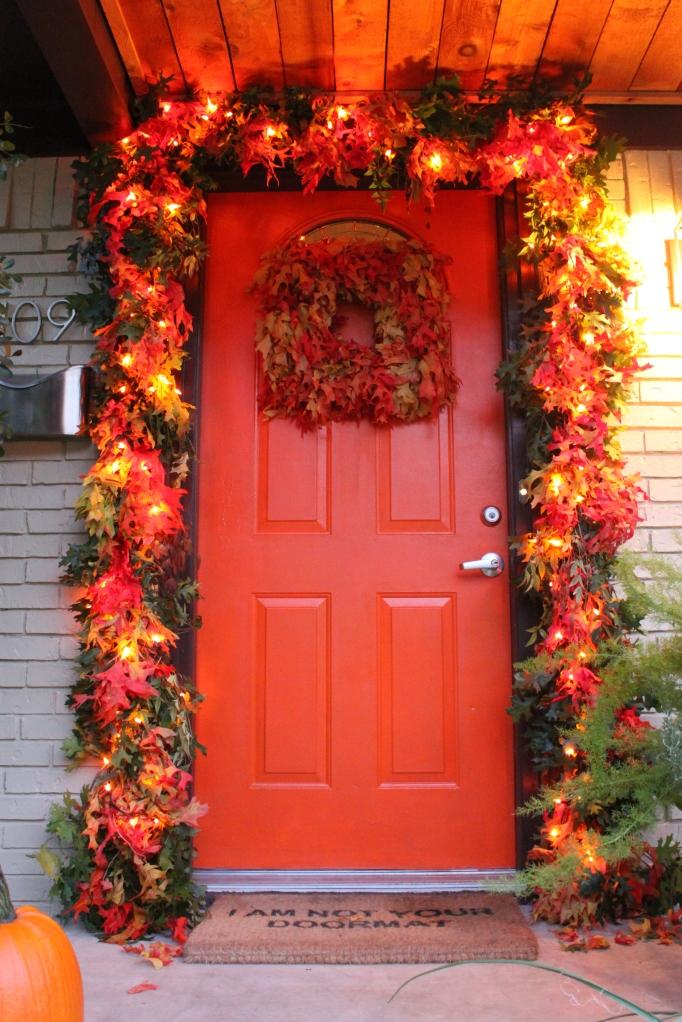The Cavender Front Door with Orange Leaf Garland