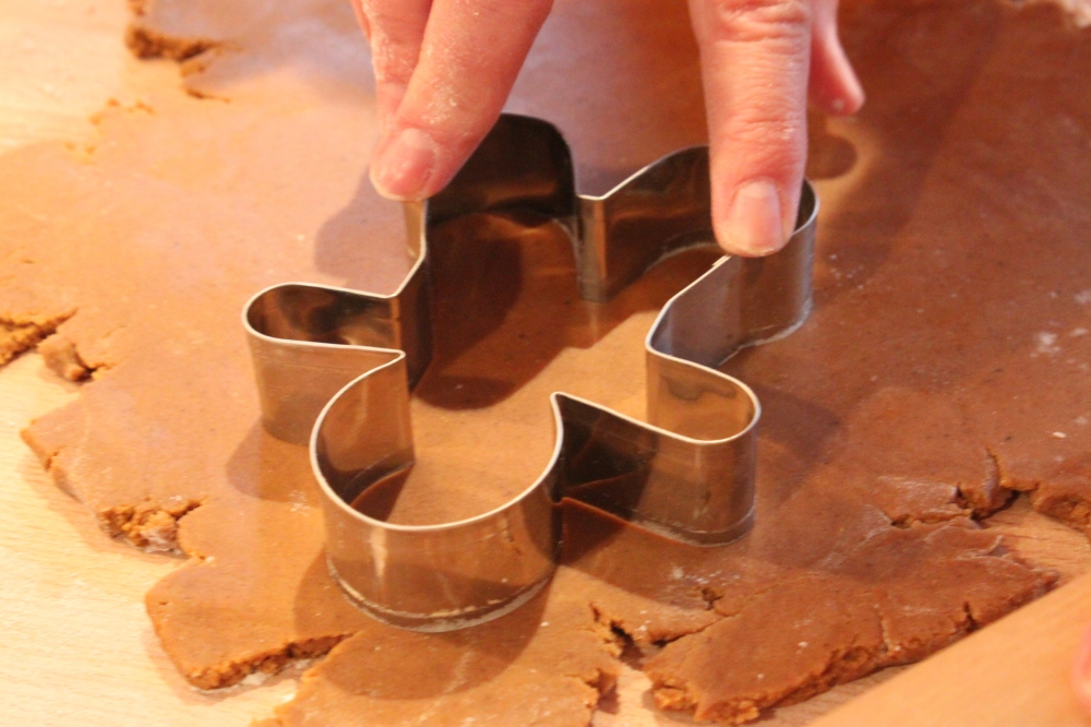 Pressing the Gingerbread Man Coockie Cutter Down