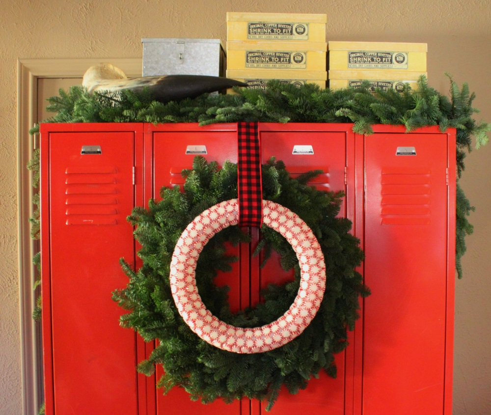 Finished Peppermint Candy Wreath on Red Lockers in the Den