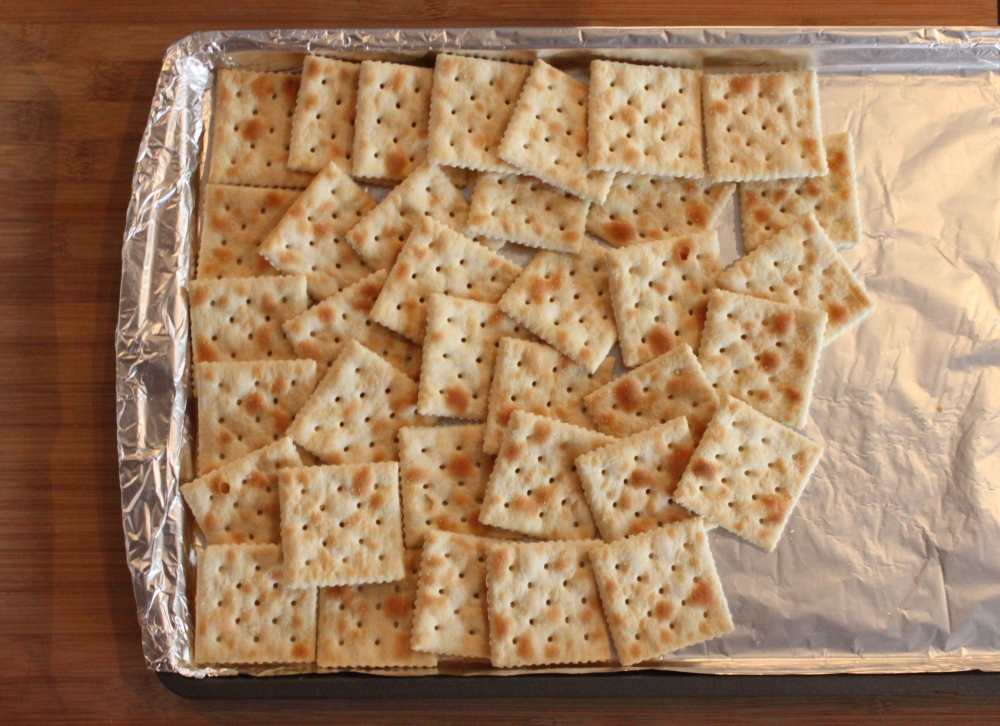 Layer the Saltines on a foil covered cookie sheet