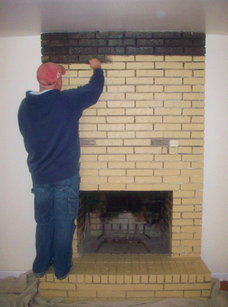 Jamie Priming the Brick Fireplace