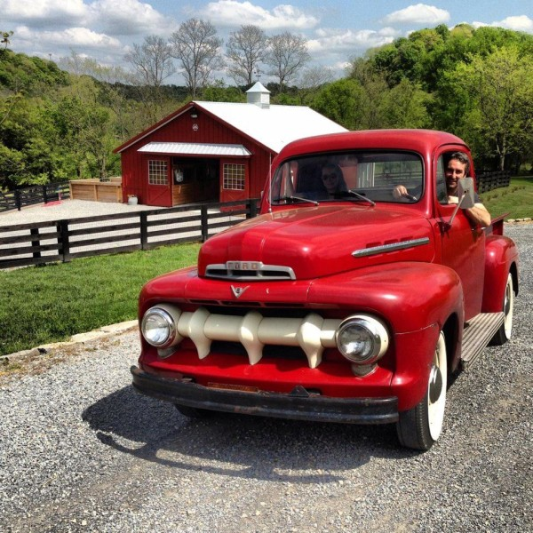 Mike Wolfe in his Vintage red Ford Pickup
