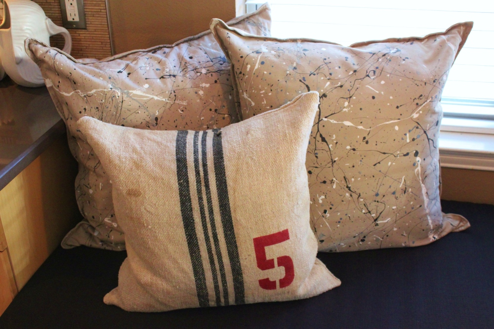 Splatter Paint Pillows and Stenciled Grain Sack Pillow on the New Banquette
