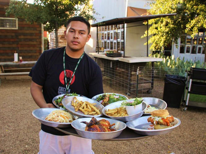 Waiter With Tray of Fried Chicken at Chicken Scratch and the Foundry in Oak Cliff