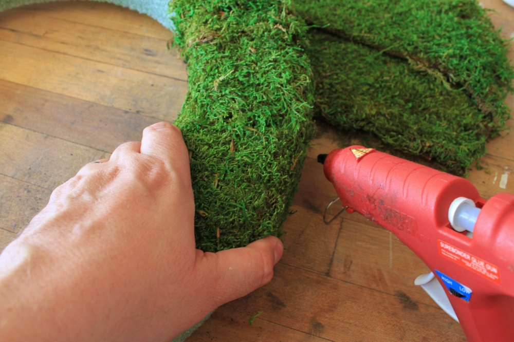 Carefully Use a Hot Glue Gun to Attach the Moss to the Wreath Form