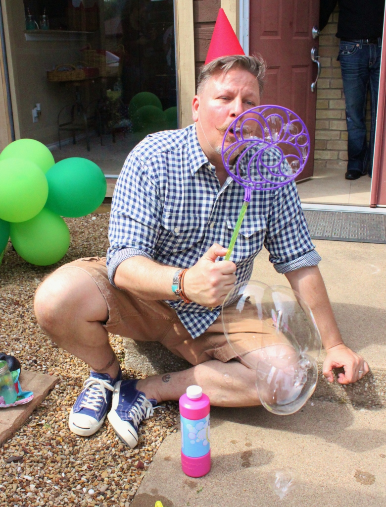 James Blowing Bubbles at the Birthday Party