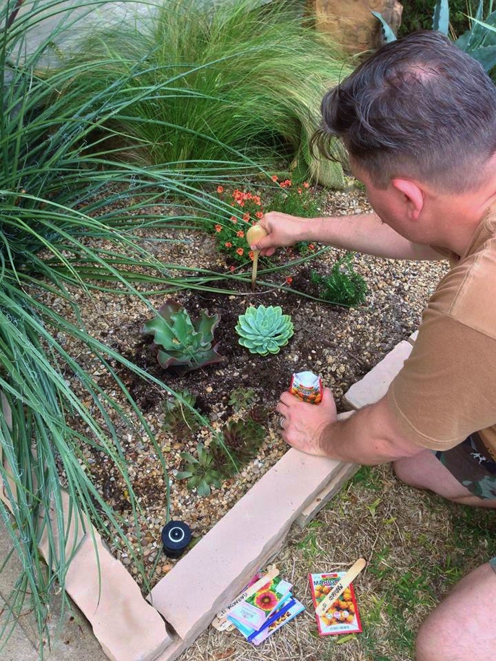James Planting in the Flower Beds