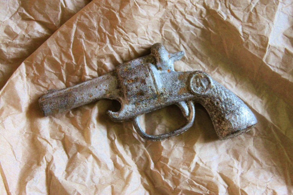 Cast Iron Gun-Shaped Bottle Opener in Question