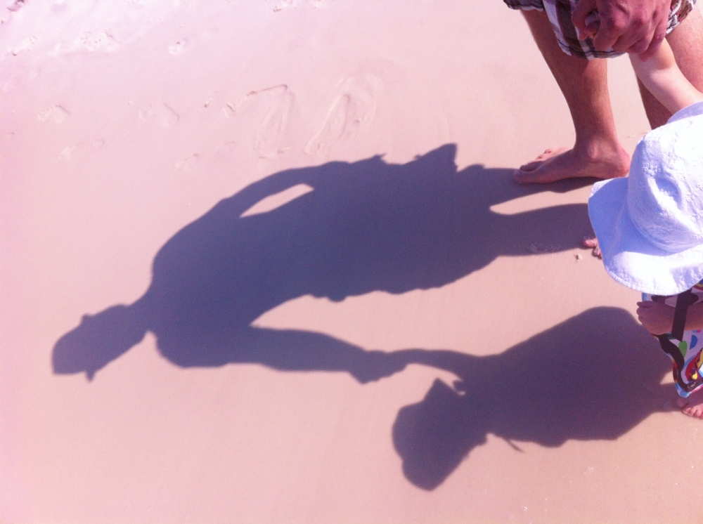 Daddy and Daughter Shadows on the Beach
