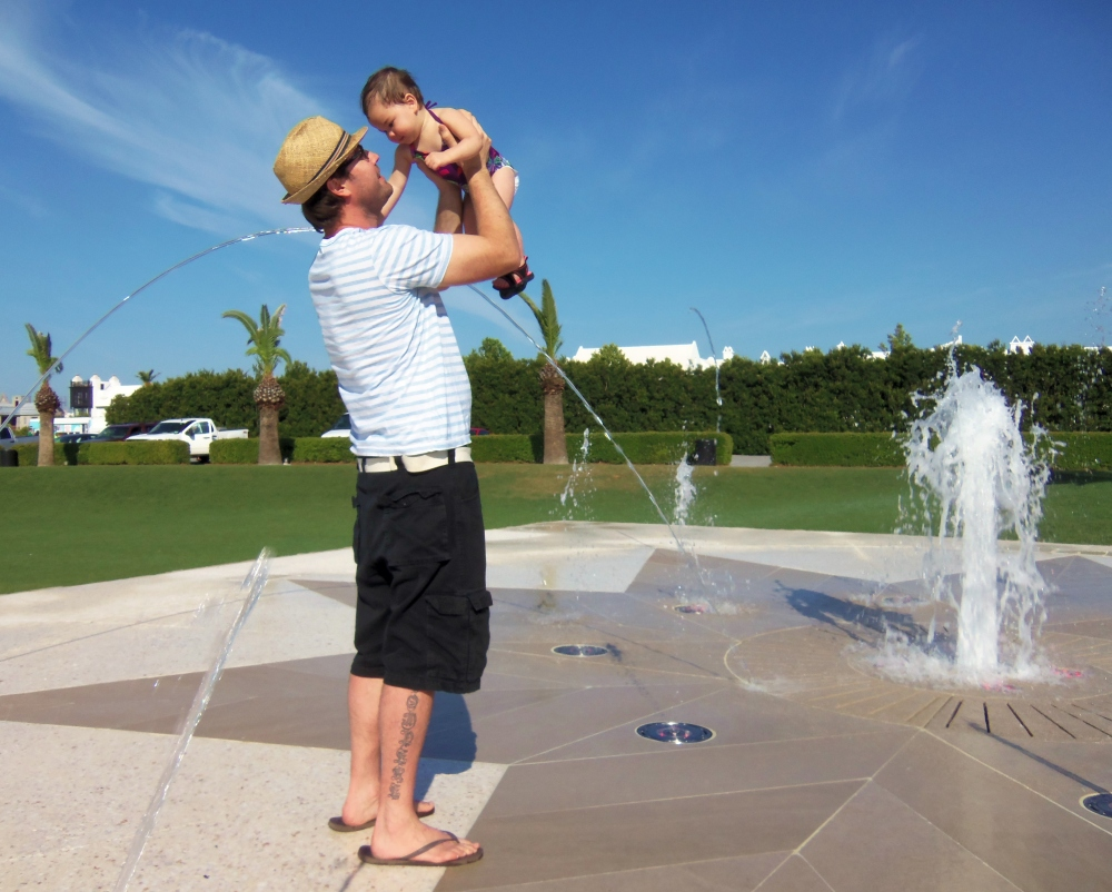 Gert and Baby Madeleine Playing in the Alys Beach Fountain
