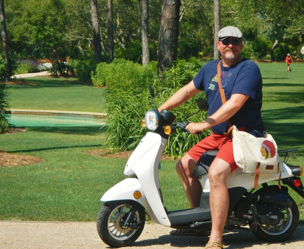 James on the White Vespa