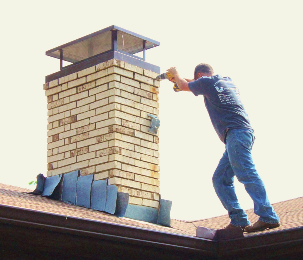 Chimney Sweep Josh Installing Our New Chimney Cap
