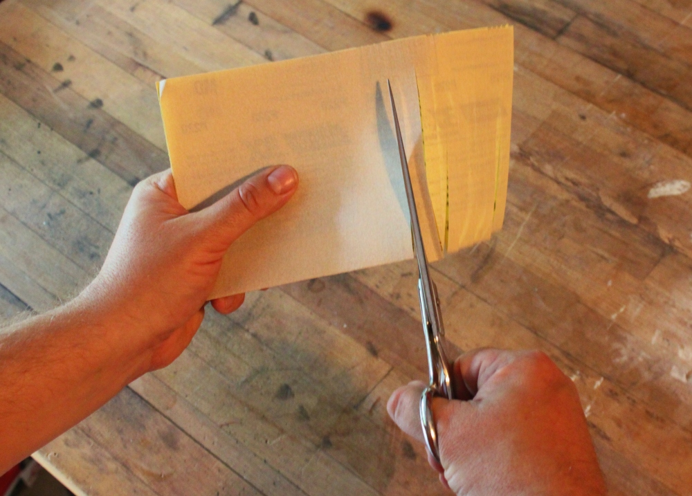 Fold the Sandpaper in Half and Cut Away with the Dull Scisors