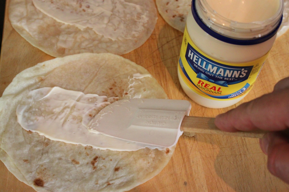 Slather a Small Amount of Mayonaise Across the Tortilla
