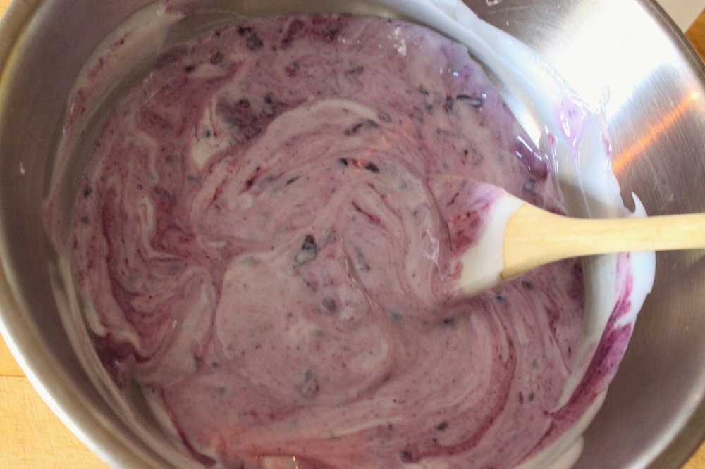 Add a few Masserated Berris to the Yogurt Mixture and Mix Gently