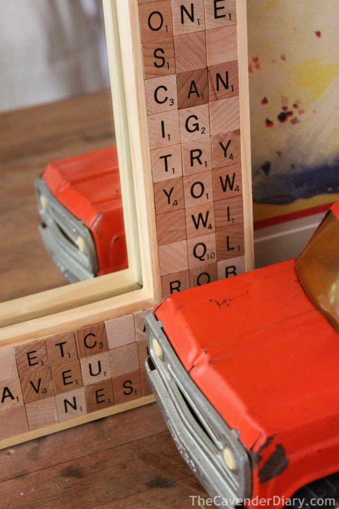Close Up of Scrabble Tile Mirror with Orange Tonka Truck