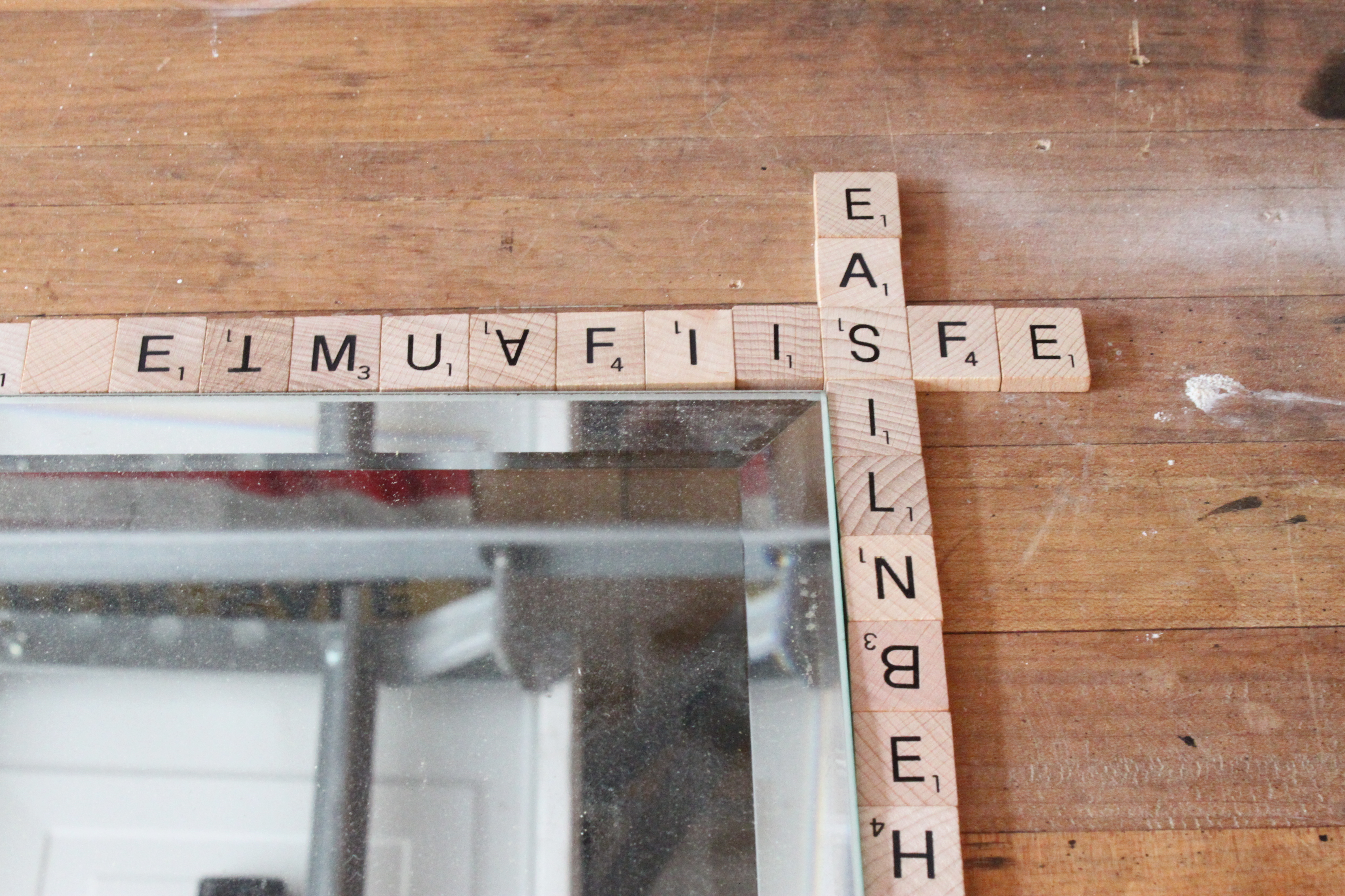 i line up the scrabble tiles around the edge of my mirror