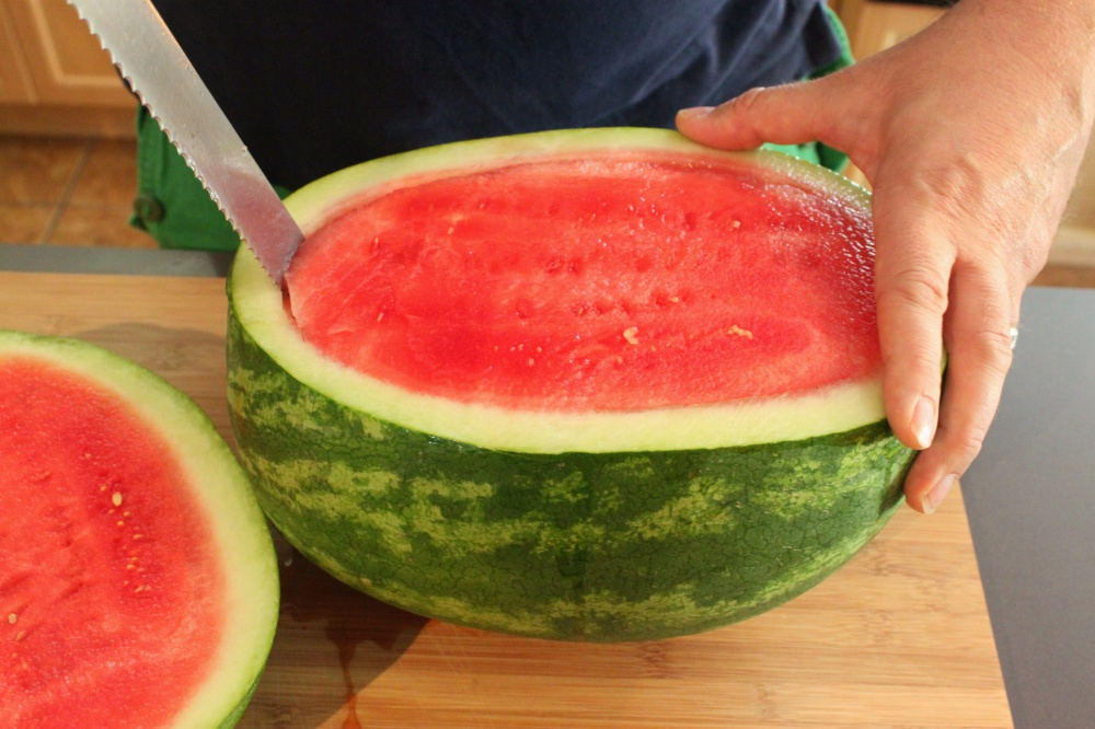 Use a serated Knife to Cut out the Watermelon