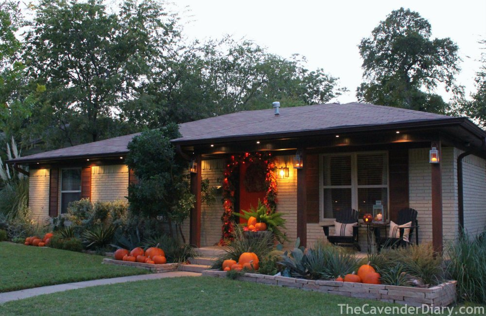 The Cavender House for October with Pumpkins in the Flower Beds