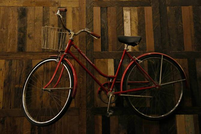 Red Bike on the Wall of the Rustic