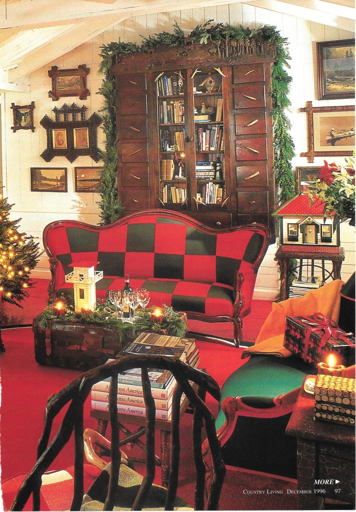 Red and Green Checkered Sofa in Front of Tramp Art Cabinet